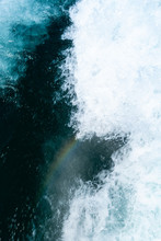 The Small Rainbow Appear Behind The Boat In Blue Raging Water