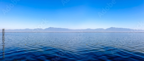 Landscape and scenic view of lagoon with mountain and blue sky background Canvas Print