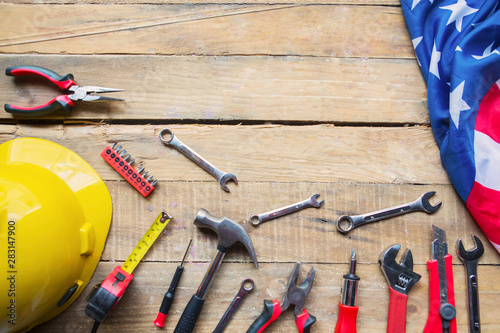 Photo Stands Asia Country Handy tools and American flag on the wooden table
