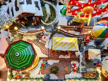 Closeup And Crop Miniature Model Santa Cruz And People In Christmas Festival. Decoration Miniature Christmas Model.