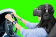Leinwandbild Motiv Woman driving in a car simulator with a VR headset