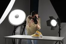 Professional Photographer Shooting Stylish Shoes In Studio