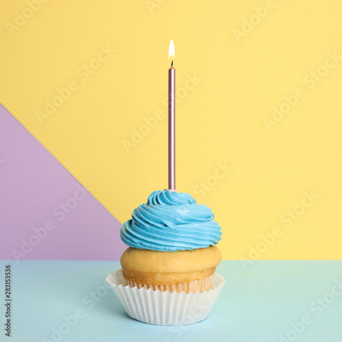 Birthday cupcake with candle on color background Wallpaper Mural