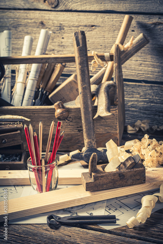 Obraz Old carpentry workbench and drawing workshop on rustic wooden table - fototapety do salonu