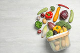 Fototapeta Fototapety do kuchni - Flat lay composition with different vegetables and basket on light background. Space for text