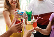 canvas print picture - Friends clinking glasses with fresh summer cocktails outdoors, closeup