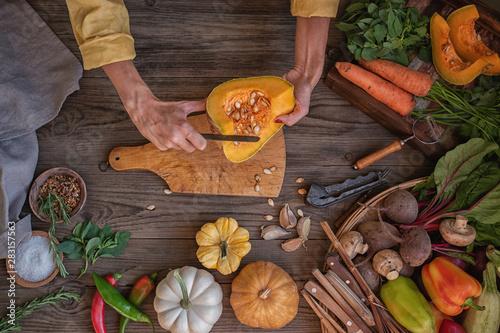Fotografiet  Chef cook preparing vegetables in her kitchen