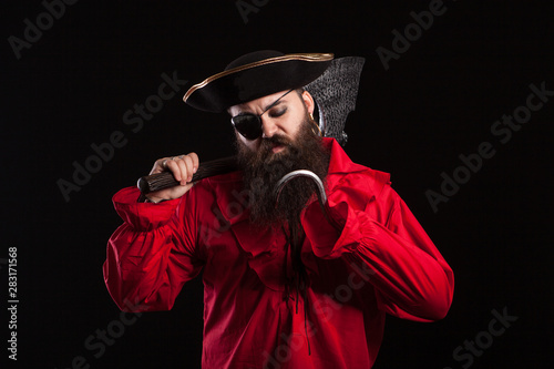 Thoughtful man in a pirate clothes for carnival with a hook insted of his hand Tapéta, Fotótapéta