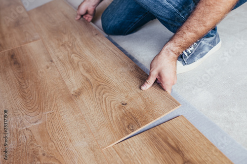 Fototapeta Laying the flooring is a complex and lengthy process that requires considerable effort - before laying the laminate on the floor, you should learn about all the nuances of the work ahead obraz na płótnie