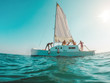 canvas print picture Group of friends having fun sailing around the sea - Young people enjoying summer tour vacation - Soft focus on guys silhouettes - Travel and fun concept - Fisheye lens distortion