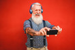 canvas print picture - Senior hipster man using smartphone app for creating playlist with rock music - Trendy tattoo guy having fun with mobile phone technology - Tech and joyful elderly lifestyle concept - Focus on face
