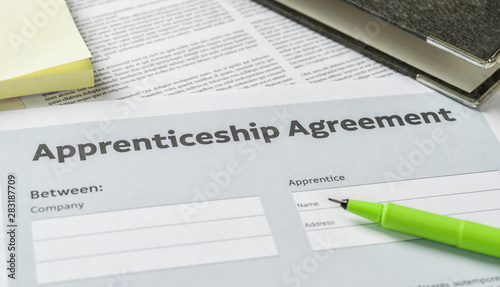 An Apprenticeship agreement with a pen on a desk Wallpaper Mural