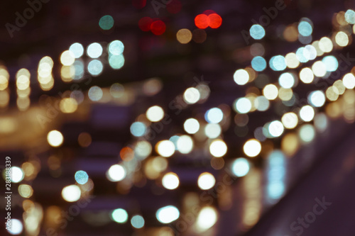 Defocused image of hard night for drivers. Big traffic in the city. In the summer urban highway filled cars. To be late. Long exposure. For greeting card design, postcard template, guide, poster.