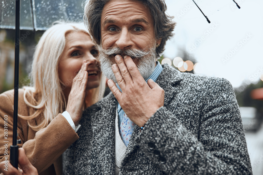 Fototapety, obrazy: Positive couple sharing little secret stock photo
