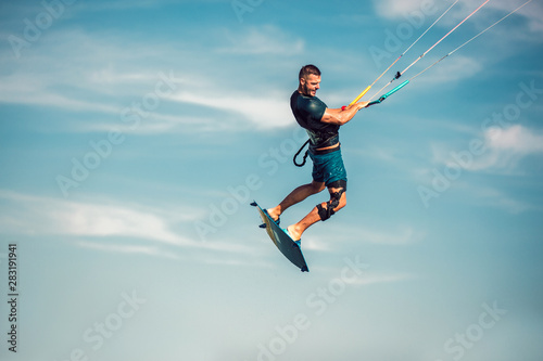 Obrazy Kitesurfing   obraz-na-plotnie-professional-kiter-makes-the-difficult-trick-on-a-beautiful-background-kitesurfing-kiteboarding-action-photos-man-among-waves-quickly-goes