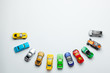 canvas print picture - Many colored little toy cars on a gray background.