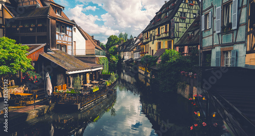 Valokuvatapetti Tranquil canals with reflections in the pretty town of Colmar, Alsace, France