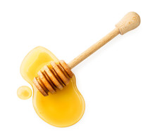 Stick With Honey On A White Ba...