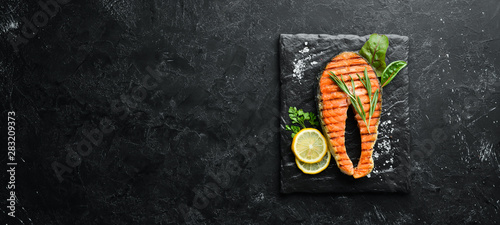 Grilled salmon steak on a stone plate Canvas