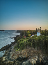 Aerial Drone Image Of The Owls Head Lighthouse Perched On The Cliffs At The Entrance To Owls Head Harbor On The Maine Coast