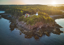 Aerial Drone Image Of Maine's Owls Head Lighthouse On The Rocky Cliffs At Sunset