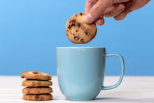 Dunking A Biscuit Into A Cup Of Tea