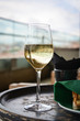 Glass with cold white wine on wooden table
