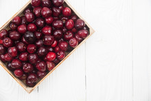 A Lot Of Fresh Sweet Cherry Fruit Berries With Water Drops, Close Up In Wooden Box. Pile Of Ripe Cherries. Large Collection Of Fresh Red Cherries. Ripe Cherries Texture Background.