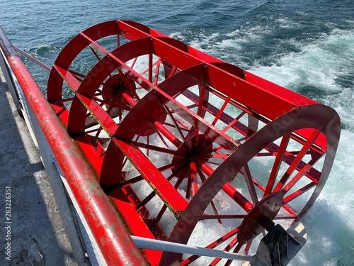Valokuvatapetti Red paddle wheel of a boat up close