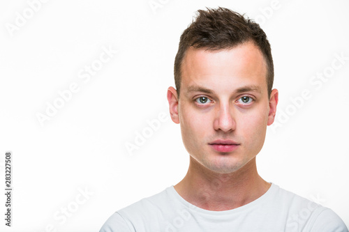 Portrait of a handsome young man on white background Slika na platnu