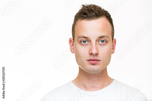 Portrait of a handsome young man, perfectly calm, facing the camera with emotion Slika na platnu