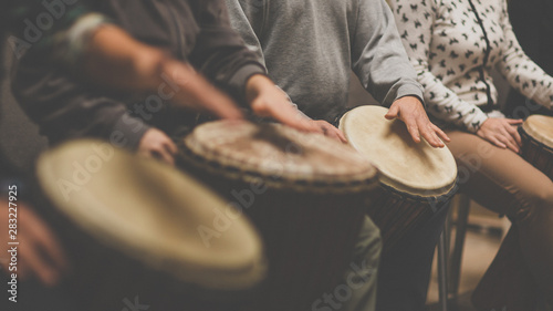 Group of people playing on drums - therapy by music - 283227925