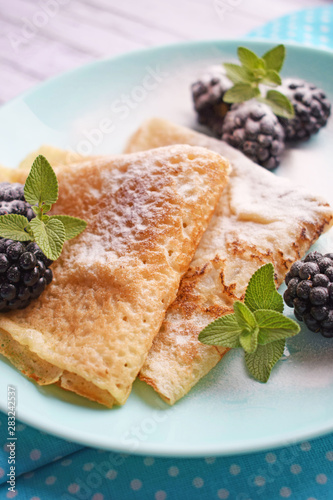 Cadres-photo bureau Dessert Delicious hot pancakes with blackberries and mint on a wooden background.