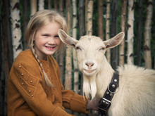 A Child And A Goat. Portrait O...
