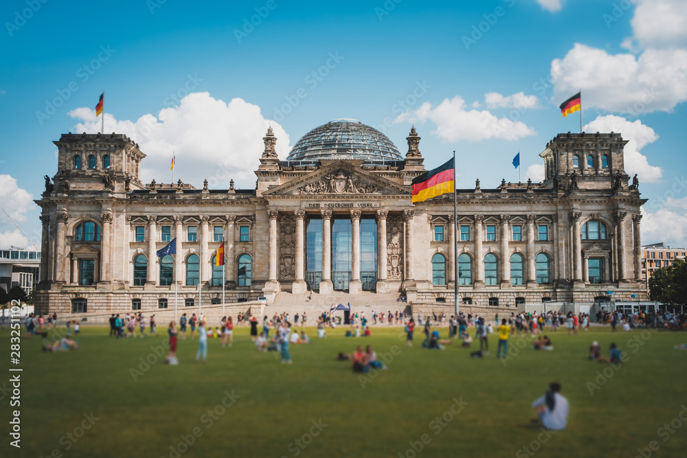 Fototapety, obrazy: Many people on meadow in front of the Reichstag building (German Bundestag), a famous  landmark on a sunny, summer day