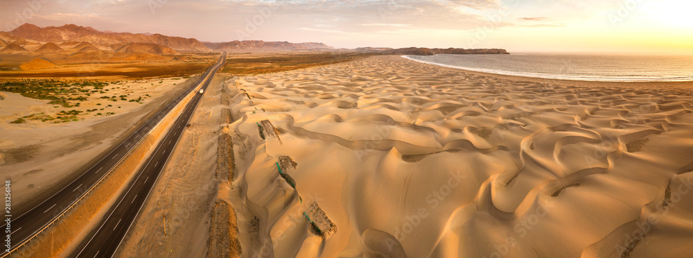 Fototapety, obrazy: Aerial view of sand dunes in the Peruvian desert at side of the Panamericana international roadway in Ancash, Peru