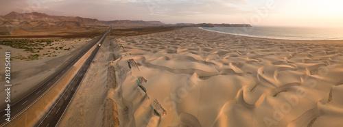 Keuken foto achterwand Kust Sand dunes of the peruvian desert at side of the Panamericana international road way. The panoramic aerial view taked in Huarmey, Ancash, Peru.