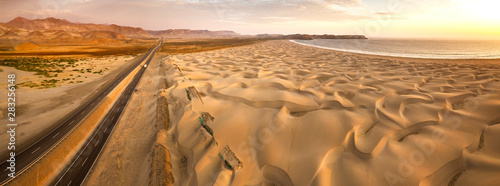 Aluminium Prints Coast Aerial view of sand dunes in the Peruvian desert at side of the Panamericana international roadway in Ancash, Peru