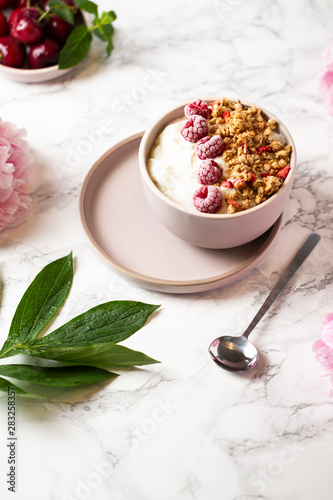 Wall Murals Flower shop Healthy crunch breakfast bowl. Greek yogurt bowl with raspberry.