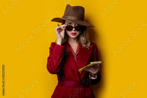 Woman in sunglasses with notebook and pen Wallpaper Mural