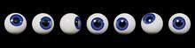Many Realistic Human Eyes With Blue Iris, Isolated On Black Background
