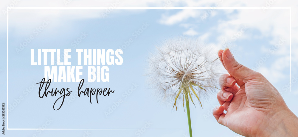 Fototapety, obrazy: Little things make big things happen. Hand holding Dandelion flower pointing to blue sky, close up photography, banner design, poster design. Positive, motivational, inspirational life quotes