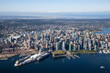 Aerial view of Downtown City, Port and Harbour in Vancouver, British Columbia, Canada. Taken during a sunny summer morning.