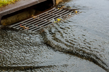 Water gushing from storm sewer following very heavy rainfall