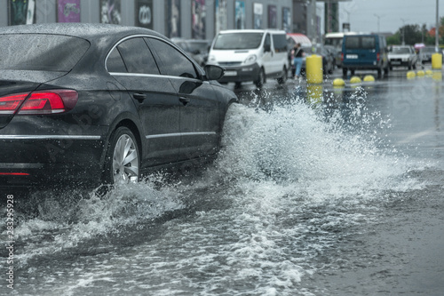 Driving car on flooded road during flood caused by torrential rains Fototapeta