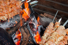 Meat Skewers Grill. Pork Or Beef Are Fried On Open Fire. Barbecue Kitchen Party Close Up Image. Kebab Or Shashlik Cooking On Spits