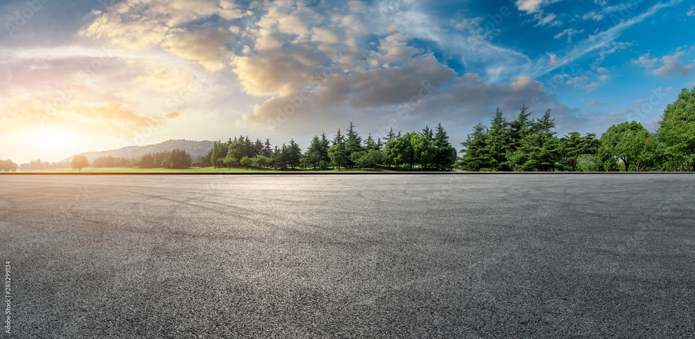 Fototapety, obrazy: Wide race track and green woods nature landscape at sunset