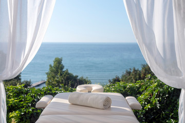 Fototapeta na wymiar Massage table with sea view
