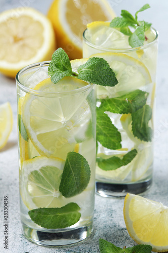 Lemon and mint refreshing cocktail with ice cubes