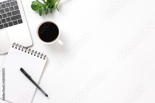 fototapeta na lodówkę Flay lay, Top view office table desk with smartphone, keyboard, coffee, pencil, leaves with copy space background.